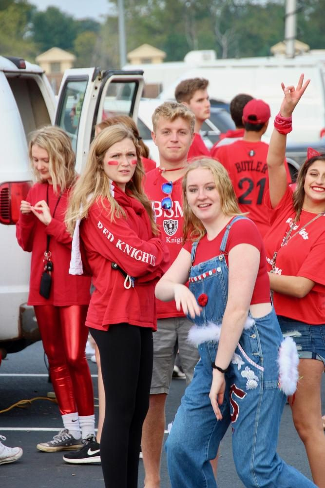 Fans of the BSM football team enjoy the perks of the fan van, including eating and lounging.