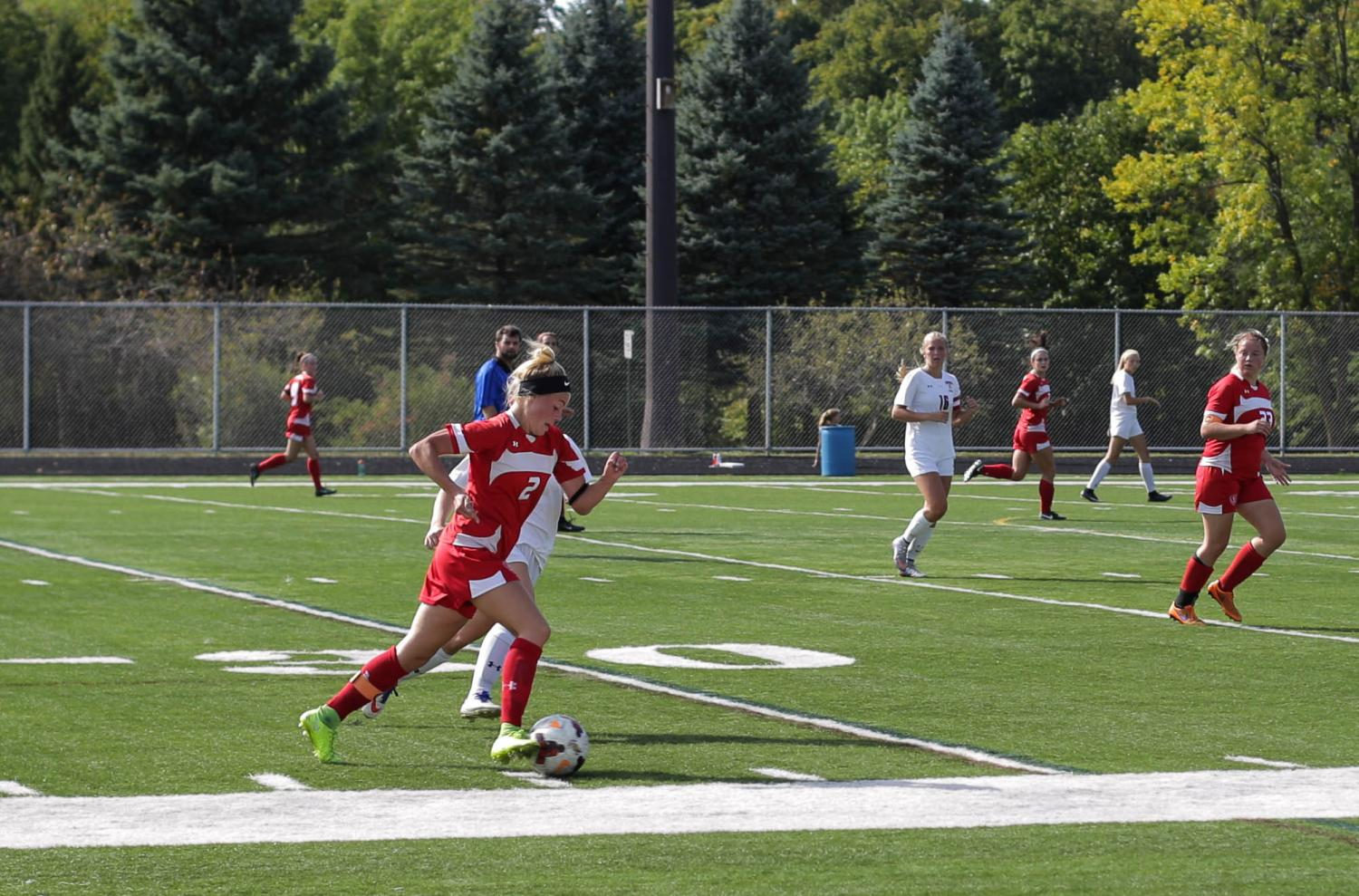 Senior captain Maddie Stoks dribbles past a defender in a recent game.