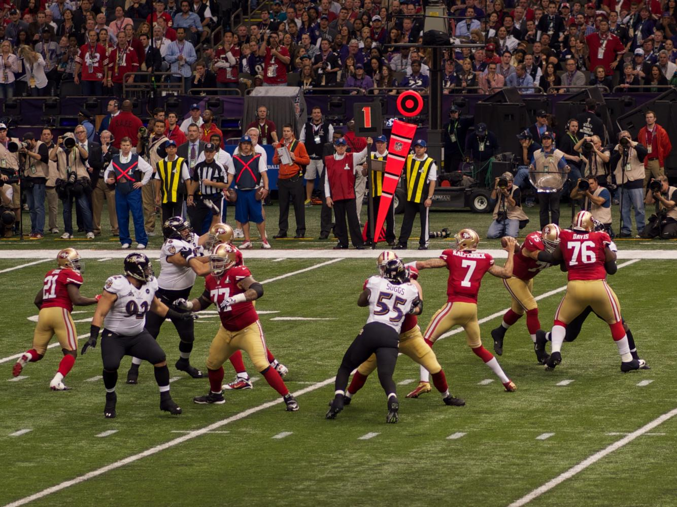Colin Kaeperick (QB #7) plays in the  Super Bowl XLVII