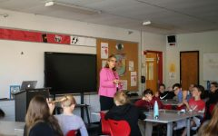 Principal Dr. Susan Skinner teaches religion to junior high students.