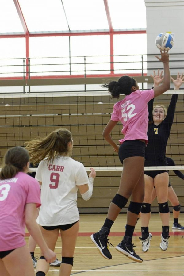 Carter Booth goes up for a kill.