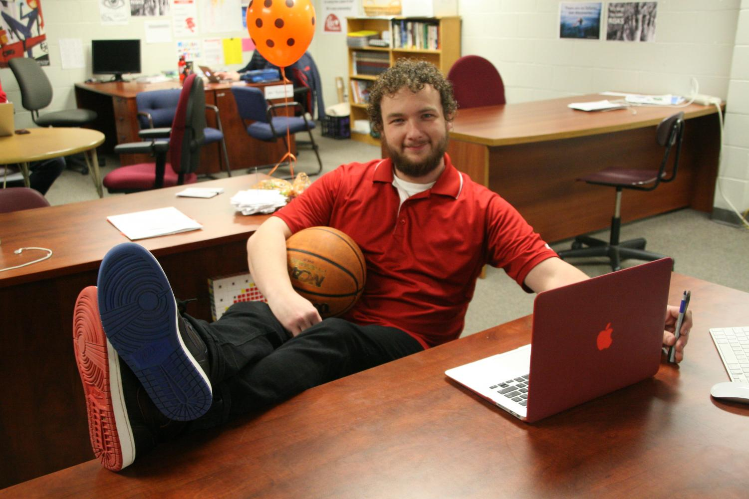 Bill Cheney lounges at his desk in a pair of his signature kicks.