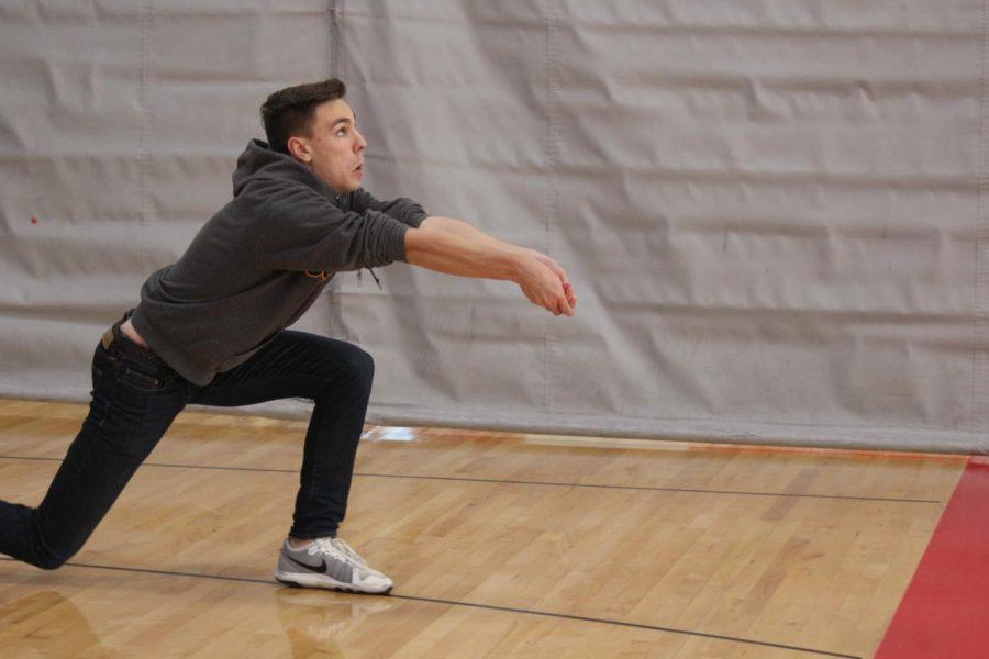 Krane tries his best in varsity volleyball practice.