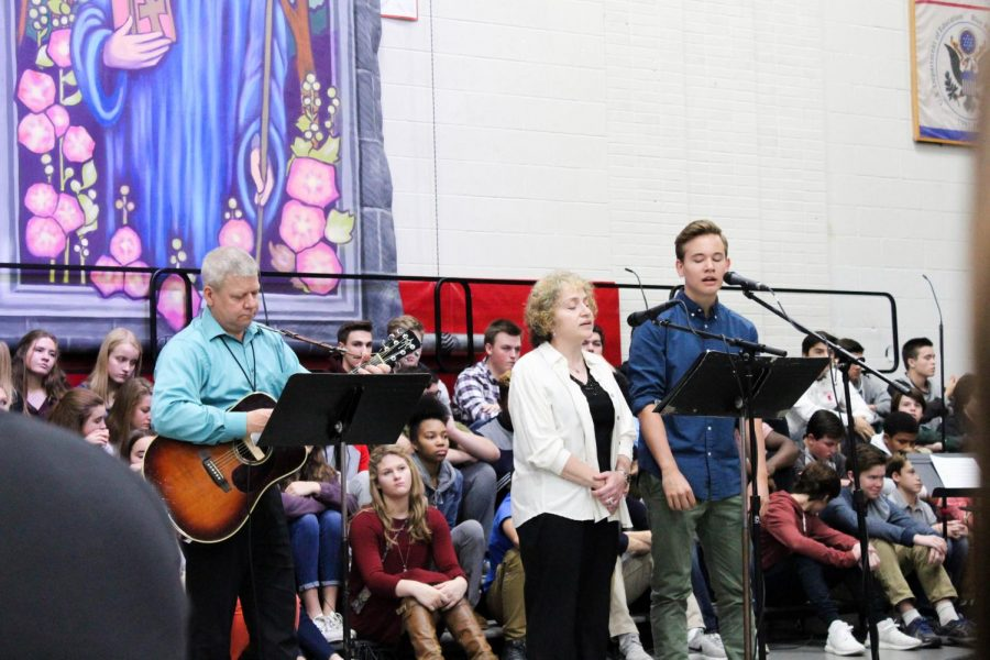 Math teacher Ms. Rosalie Goldberg and senior Noah Bridges perform a song to celebrate their Jewish heritage.