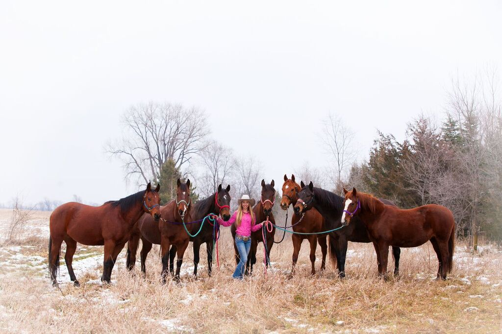 Junior Jillian Zaun poses with her horses.