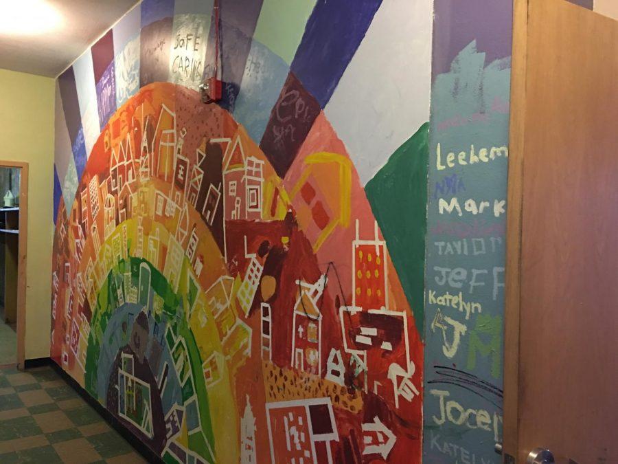 A mural at the UAA where Junior Myrka Zambrano volunteers.
