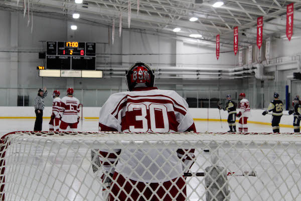 Freshman Carson Limesand standing in the crease