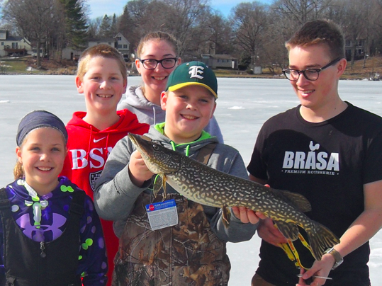 Ice fishing can often give students the opportunity to catch big fish, like this Northern Pike.