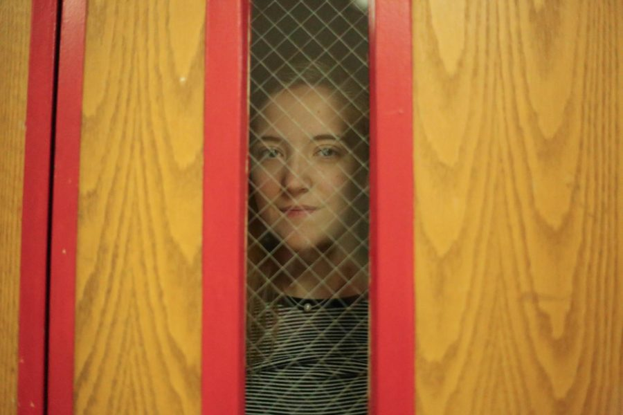 Yes, this picture is creepy. Staff Writer Kelly Dempsey gives ominous glares through the Great Hall door windows.