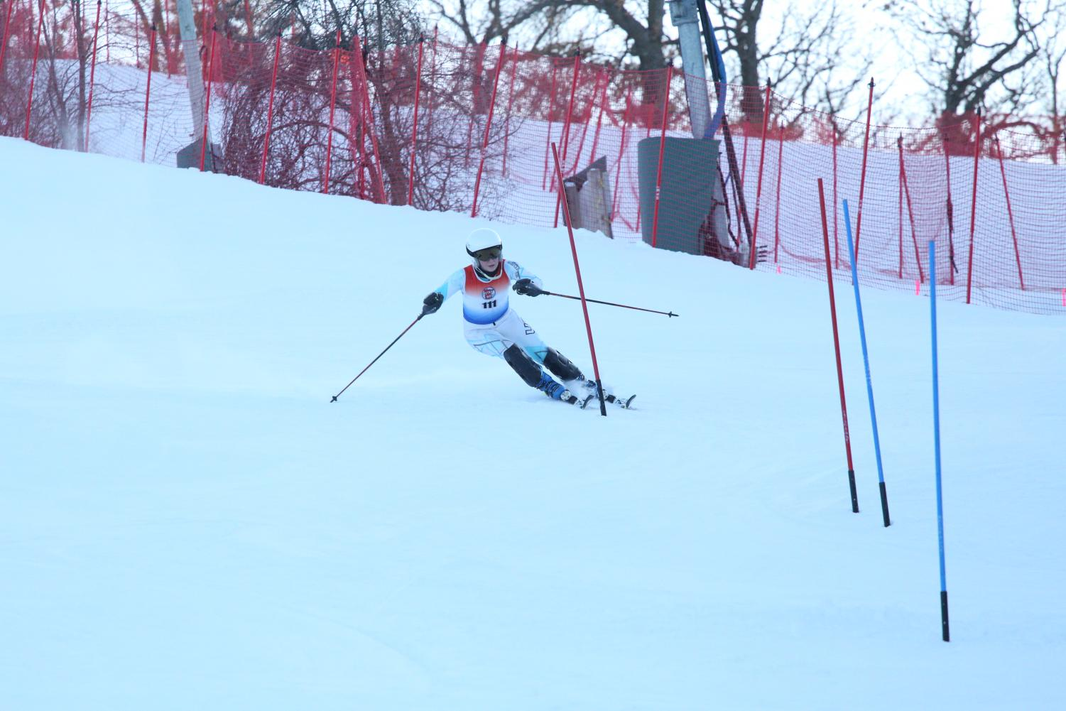 Sophomore Abigail Swanson hitting a gate at Afton Alps
