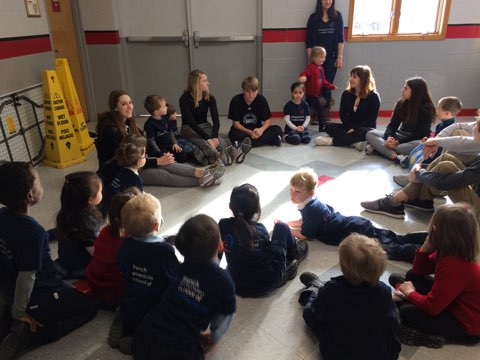 After the French III students read their stories, the younger children played Duck-Duck-Goose.
