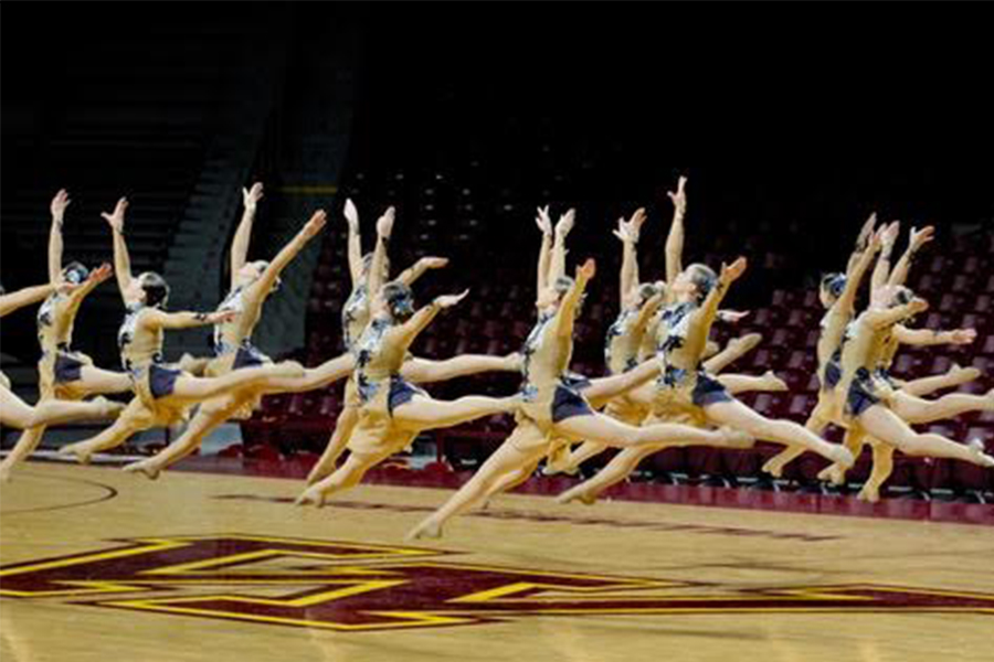 Knightettes leap during the dance at