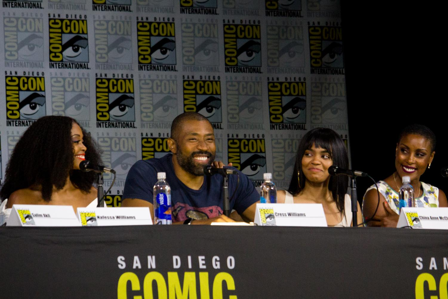 The cast of Black Lighting speak at a panel at SDCC 2017. Notable actors in the show include Cress Williams and China Anne McClain.