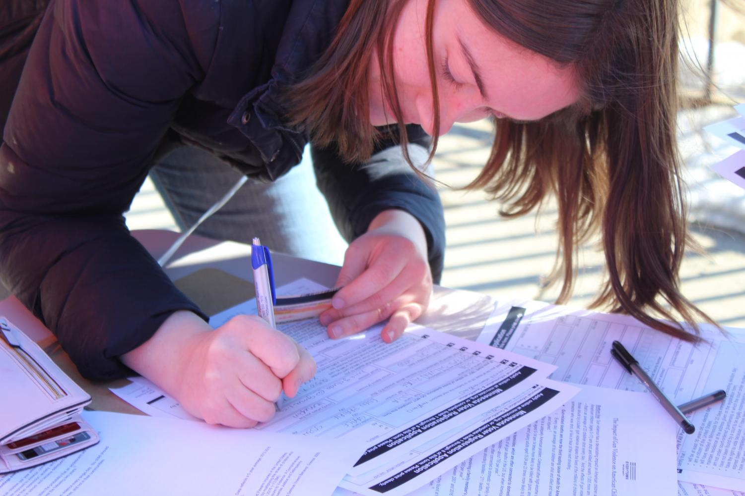 Students register to vote during the nationwide walkout.