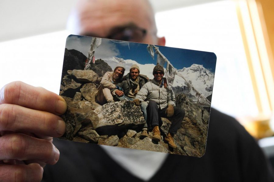Math teacher Mr. Dan Bowler holds up a photo depicting his time in Nepal. Bowler traveled to Nepal as a part of the Peace Corps in 1988.