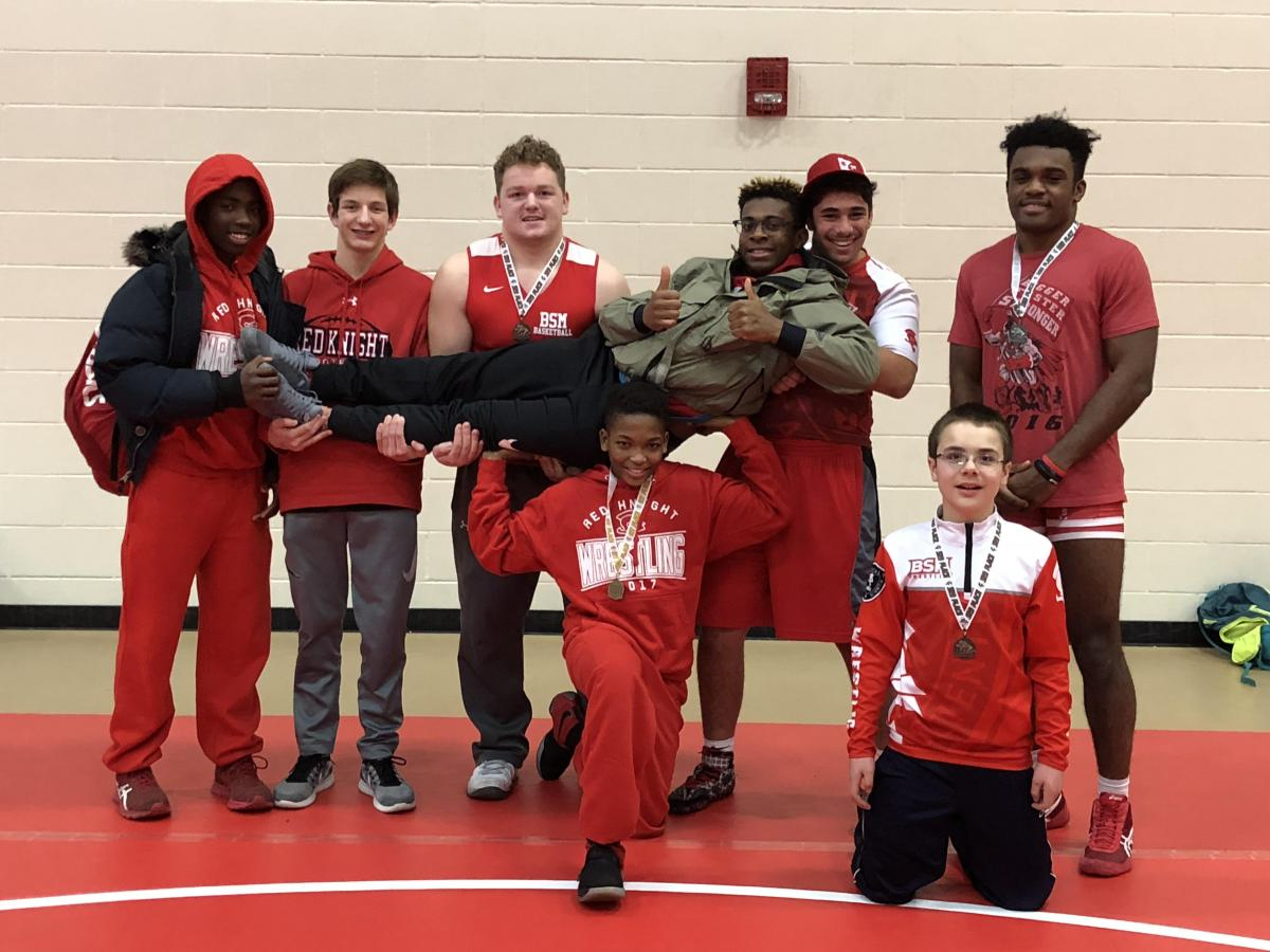 Zyan Hall (center, kneeling) took 6th place at the State Wrestling Meet. Members of the BSM wrestling team posed for a photo earlier this season.