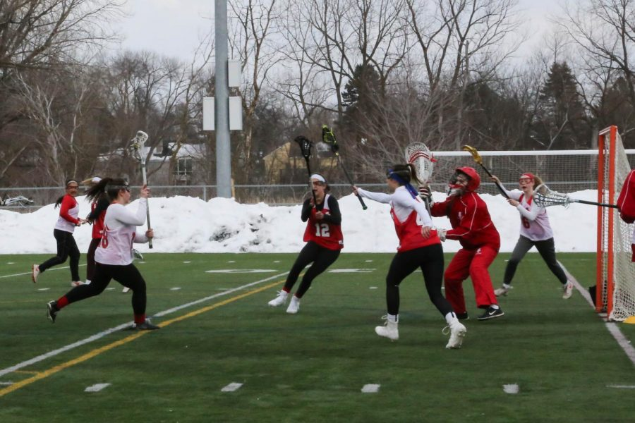 Despite+the+snow+surrounding+the+field%2C+members+of+the+girls%27+lacrosse+team+get+ready+for+the+season.+Personal+workouts+and+captains%27+practices+have+been+a+part+of+their+off-season+preparation.