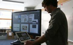 Teacher Zach Zimney uses technology often to teach his graphic design classes.