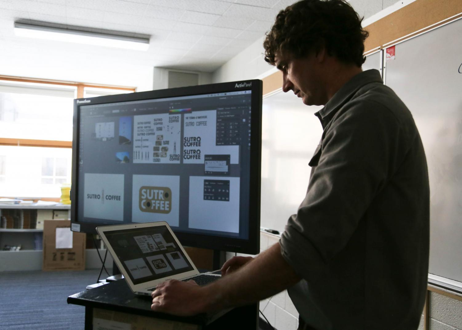 Teacher Zach Zimney uses technology often to teach his graphic design classes.