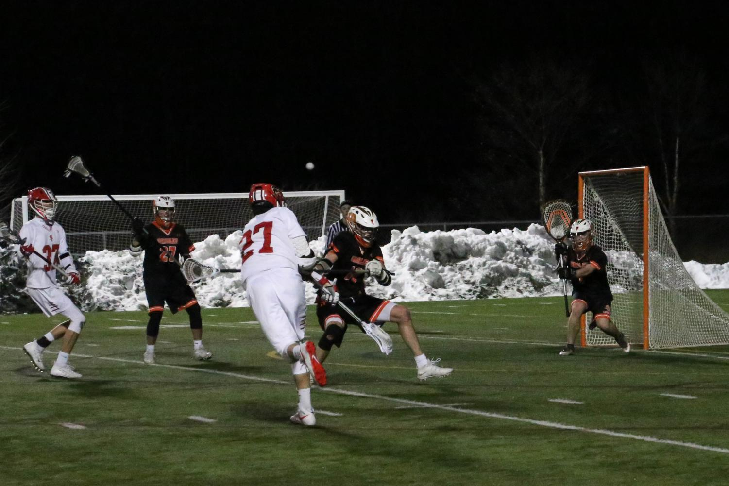 Senior Captain Eric Weber whips ball on close ranged shot.