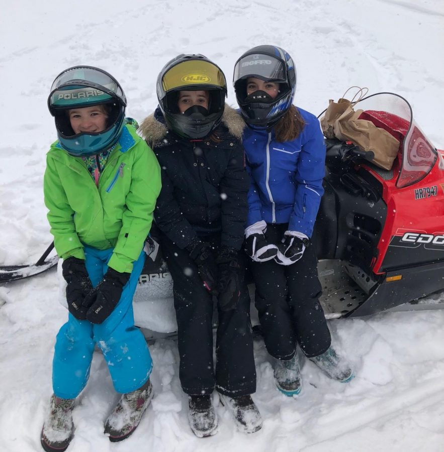 The French exchange students spent their time in Minnesota trying new things. This includes snowmobiling, as pictured.