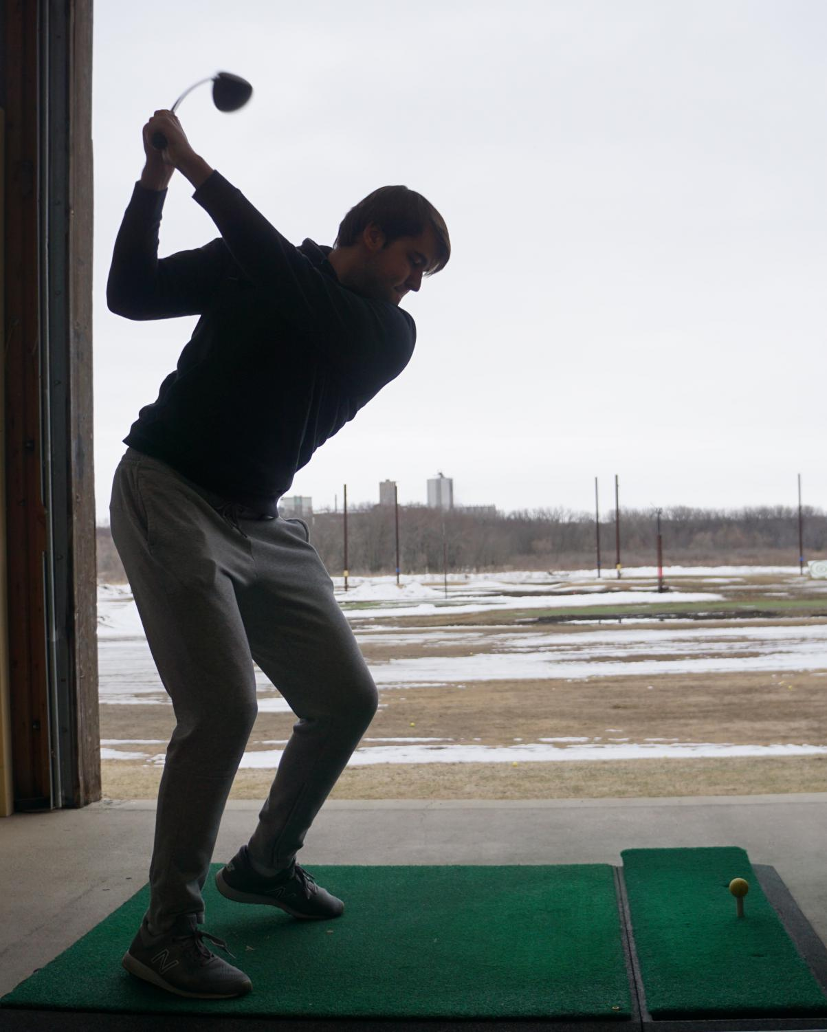 Senior Max Byzewski and the other golfers practiced indoors.
