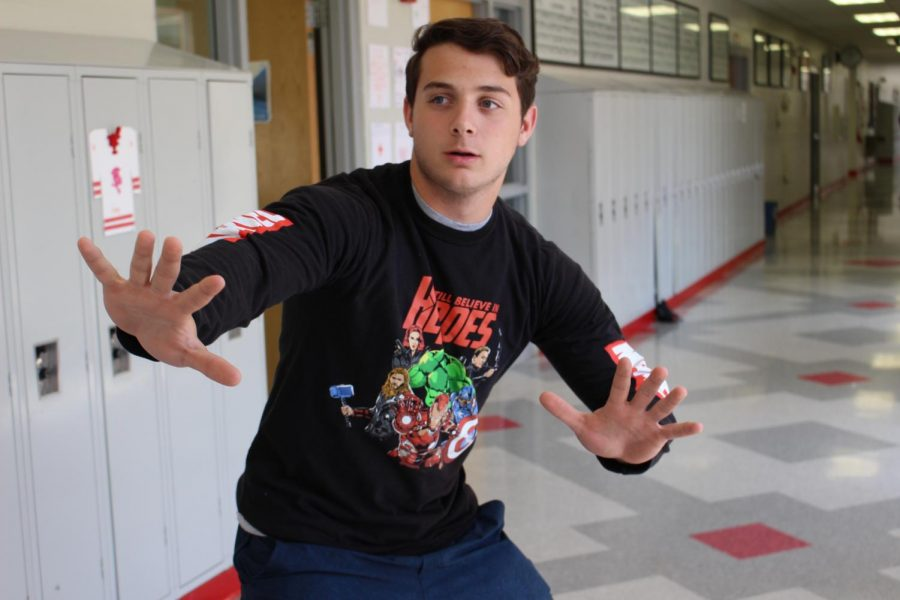Sophomore+Luke+Mathwig+poses+with+his+Avengers+shirt.+He+is+thrilled+about+this+summer%E2%80%99s+upcoming+Marvel+movies.