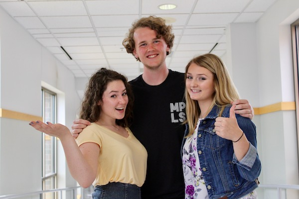 Sophomore Teddy Dayton pictured with seniors Elke Thielen (left) and Grace Ryan (right).