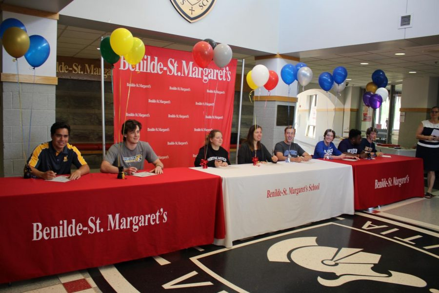 Seniors sat in the entryway to celebrate their signing with athletics and military service for next year.