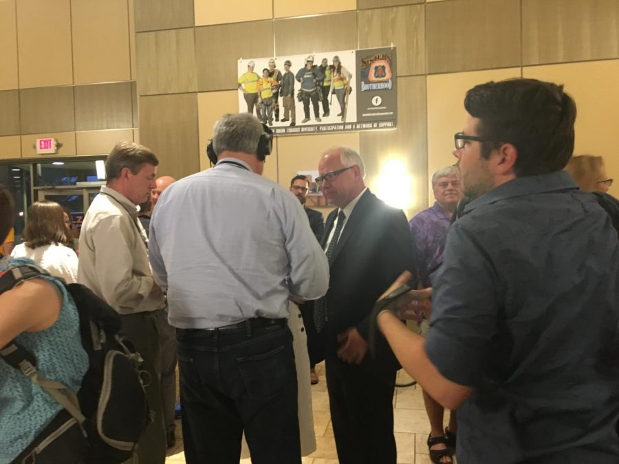 1. Canidate Tim Walz gives speaks with journalists before election results are in.