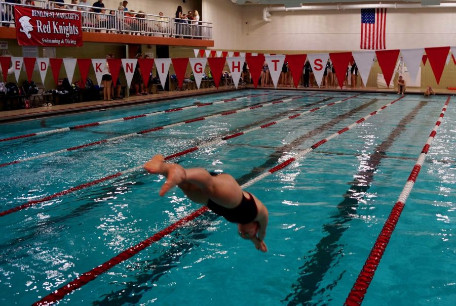 Junior+Quinn+Elsenbast+and+the+BSM+girls%27+swim+team+dives+into+the+season.
