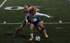 Ashtyn Lowenberg forces ball out of bounds, killing time in BSM's 3-0 win.