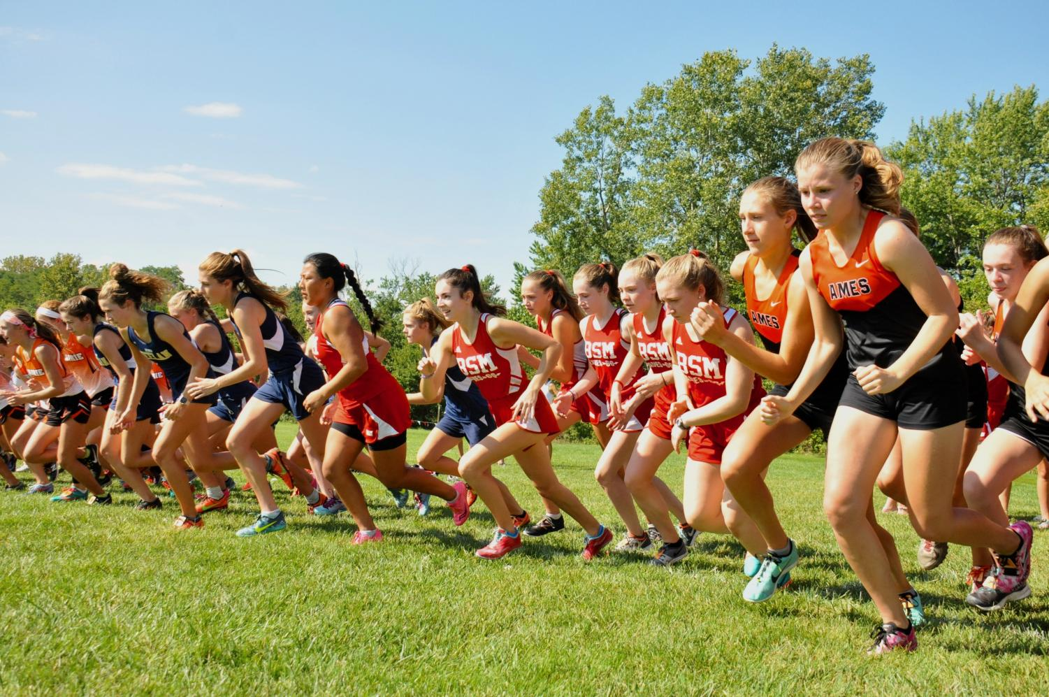 Girls' cross country aims for victory this year through team building and  working hard.
