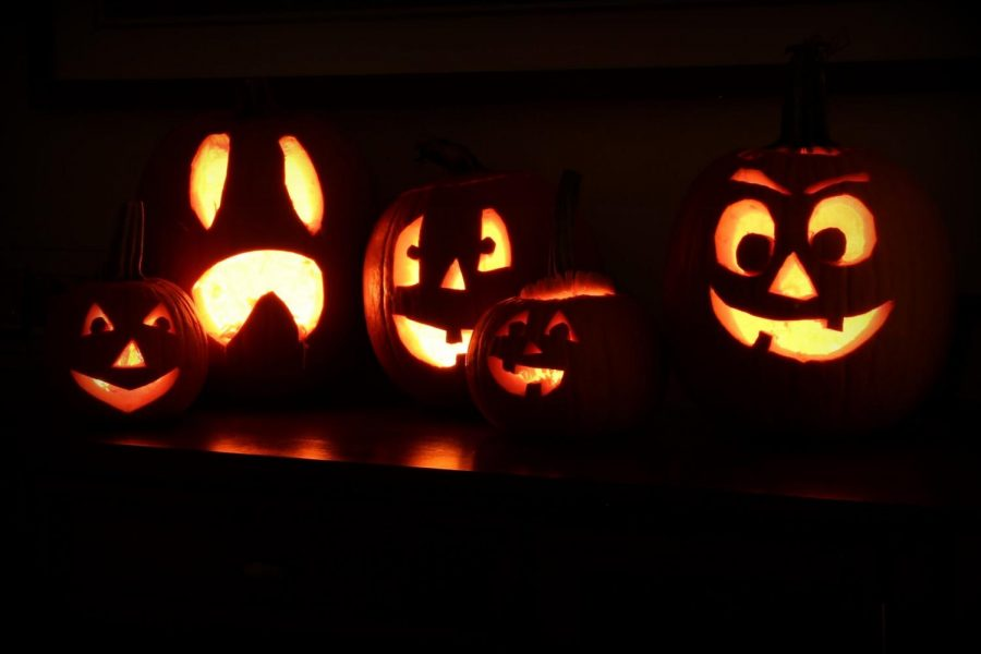 It%27s+spooky+season+and+front+steps+all+over+are+filled+with+jack+o+lanterns.