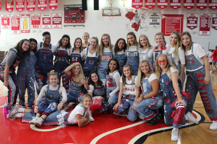 Senior+girls+show+off+their+overalls+at+the+annual+homecoming+pepfest.+