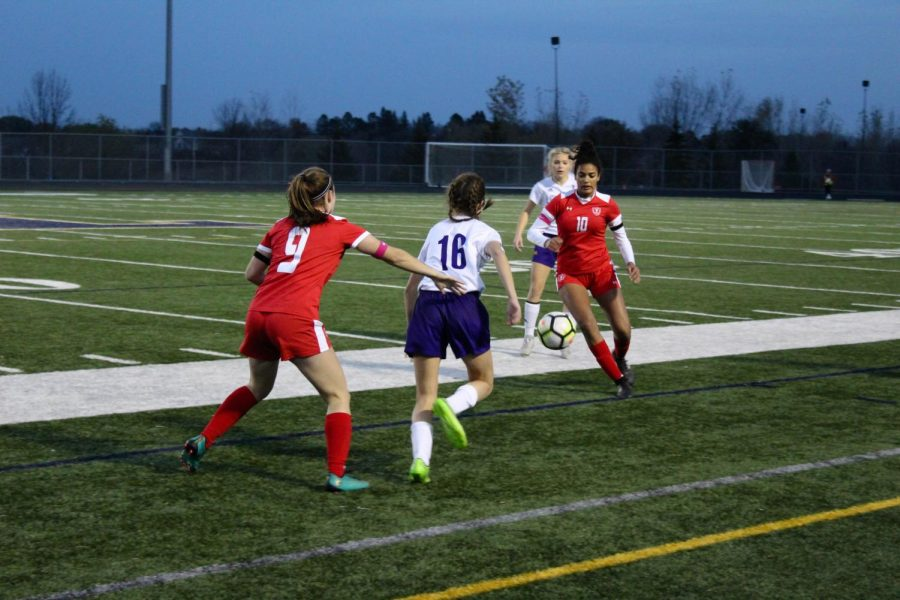 Attacker Sophie Coleman looks to pass ball to Erin Long.