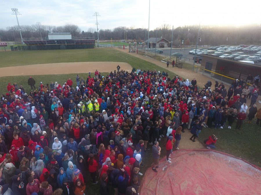 The entire student body gathered on the baseball field during homeroom to take part in the cross blessing.