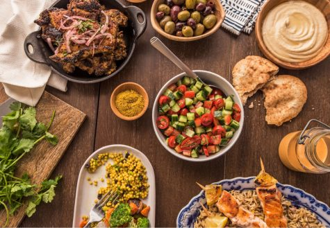 Different foods and meals found at Roti spread across a table