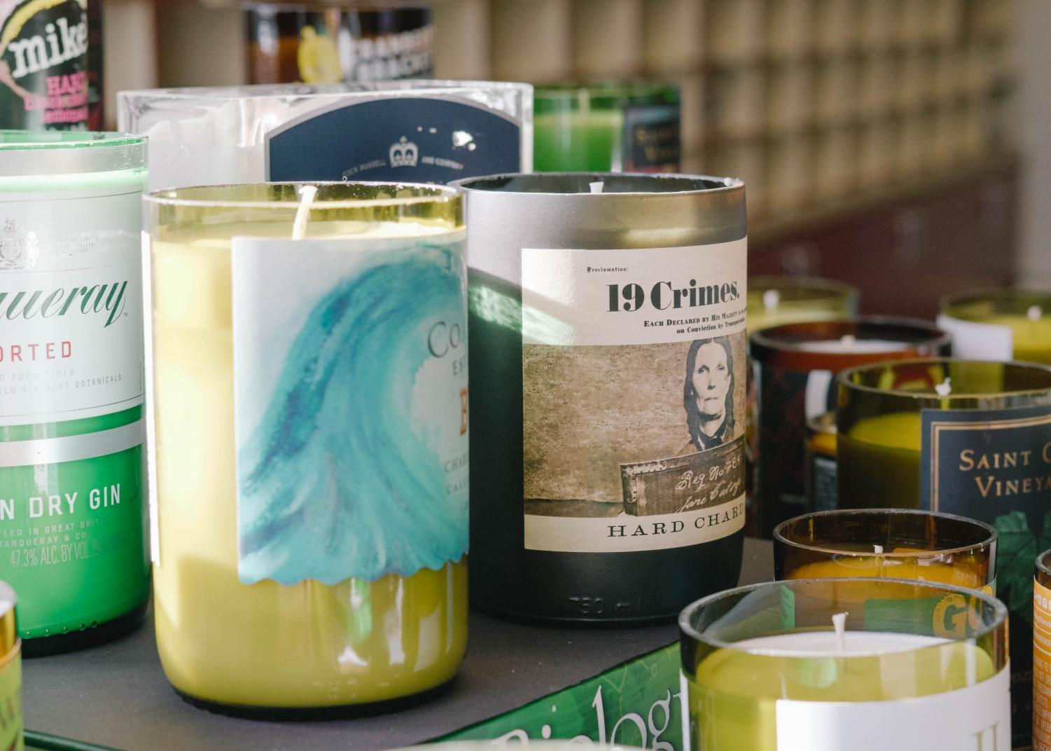 Lyons uses recycled bottles to make the mold for his candles.