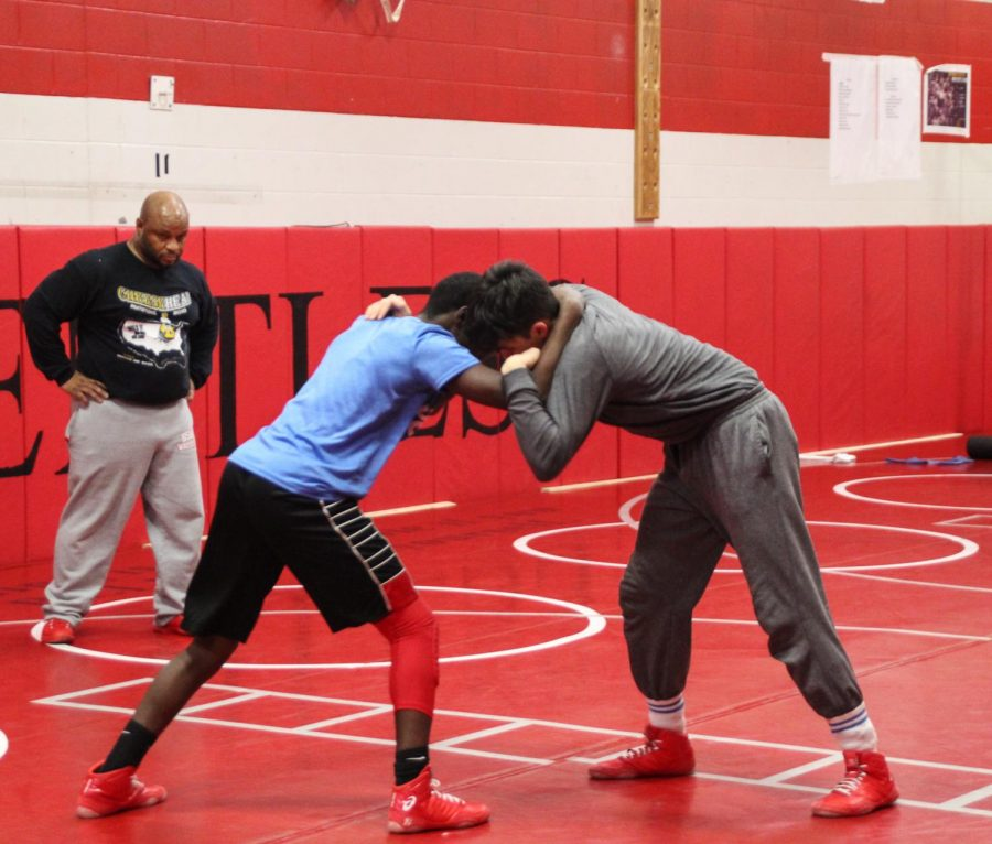 The wrestling team learns new skills during practice.