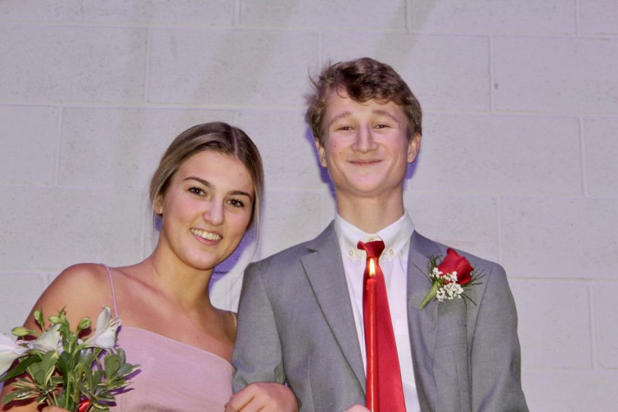 Seniors Taylor Anderson and Grand Knight Nominee Daniel Monchamp smile on stage at the coronation ceremony.