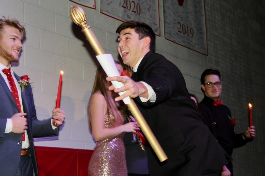 Senior MC Matthew Hansberry dances around the stage before announcing the 2019 Grand Knight.