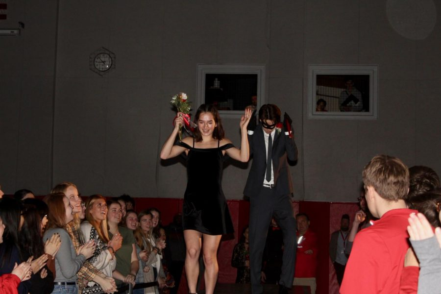 Seniors Sally Calengor and Grand Knight Nominee Connor Lawler slickly strut down the runway.
