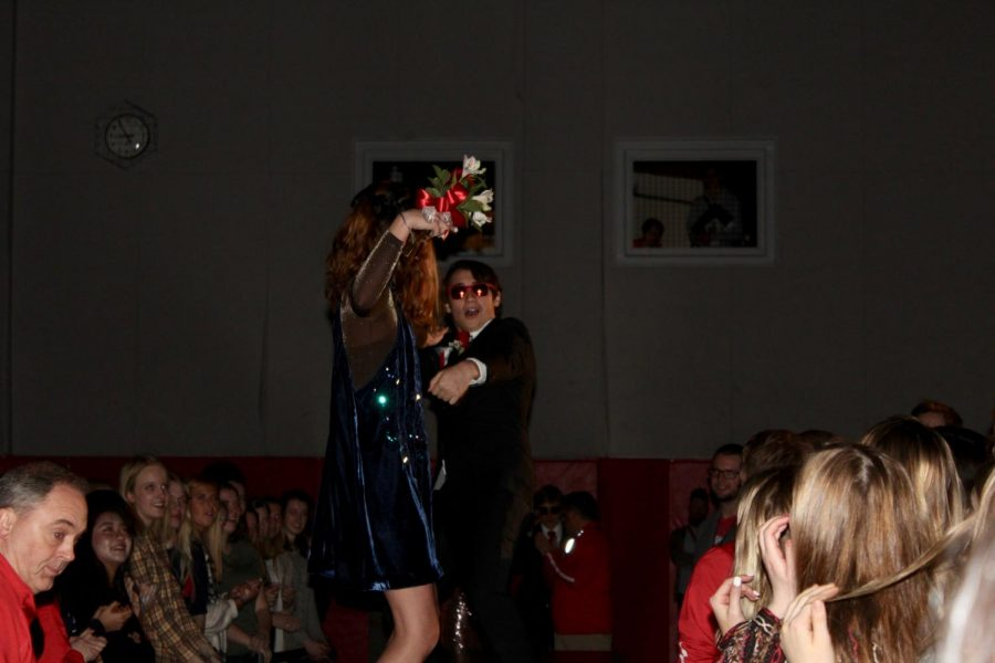 Seniors Emily Platt and 2019 Grand Knight winner Brad Shibley block out the haters with their shades during their runway walk.