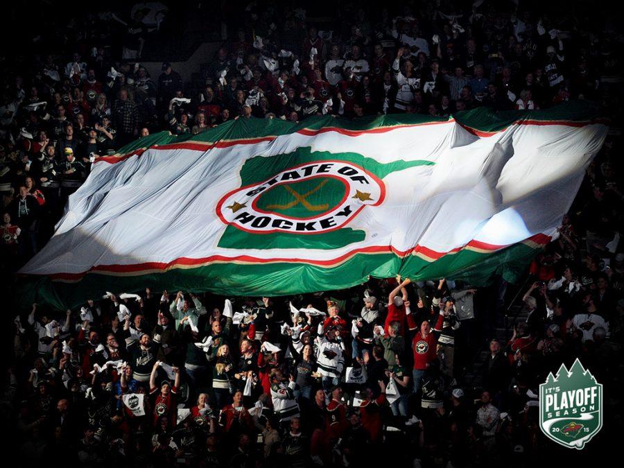 Minnesota Wild fans hoist State of Hockey flag in honor of professional hockey returning to Minnesota.