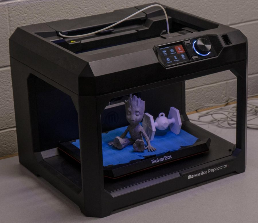 Students in the 3D Make It class use 3D printers, vinyl cutters, and laser cutters in order to create their art pieces.