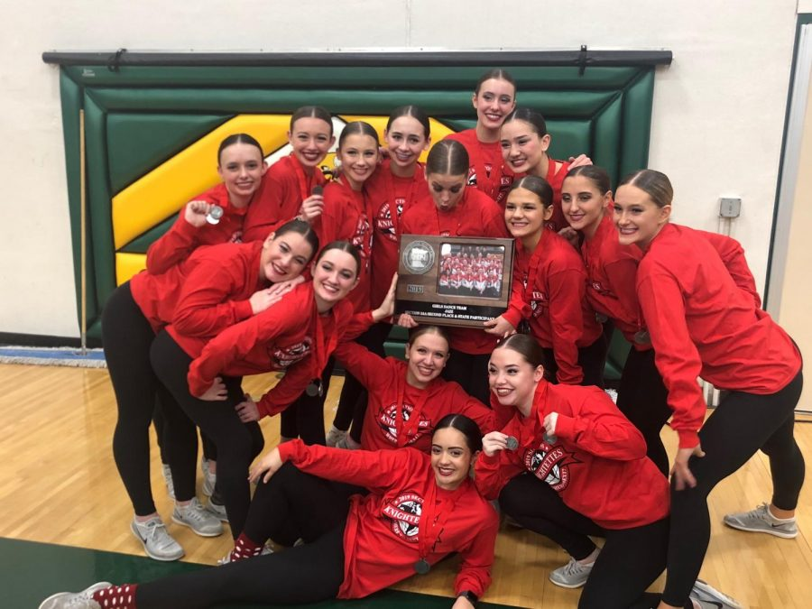Dance+team+celebrates+after+placing+at+sections+qualifying+for+state.