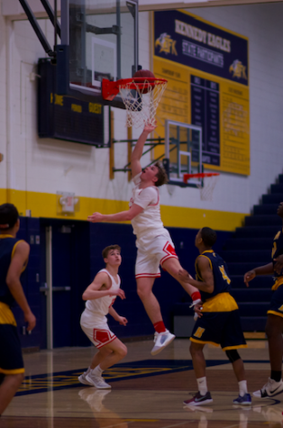 Junior Zach Carden goes up for a shot to help the Red Knights get a win.