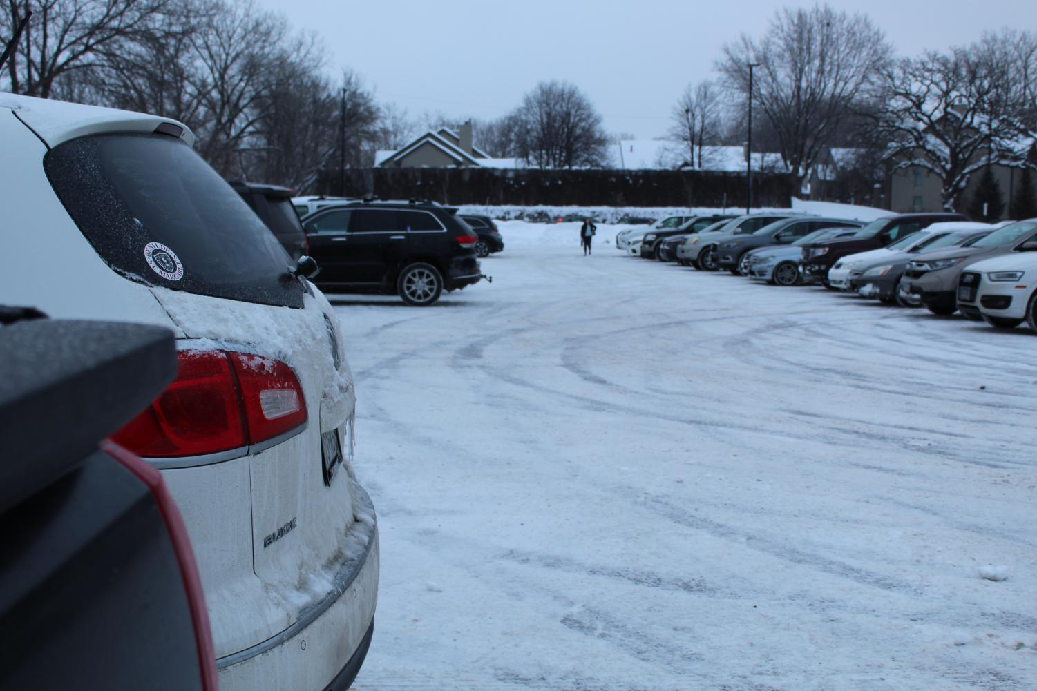 The frigid winter weather left the school parking lot icy and dangerous.