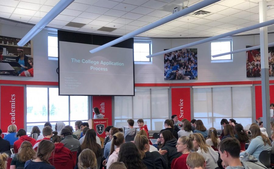 BSM Juniors gather in the library for a seminar on writing college essays, and the college application process.